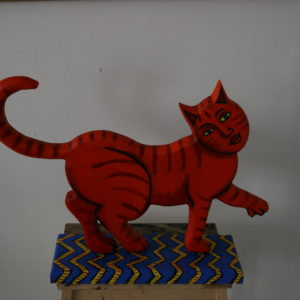 Red cat on blue rug